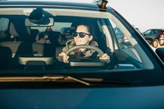 Young woman or girl driver inside the car. Stock Photos
