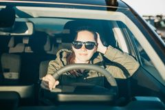 Young woman or girl driver inside the car. Stock Photo
