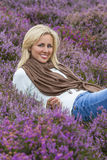 Young Woman Girl in Field of Purple Heather Flowers Royalty Free Stock Photography