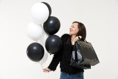 Young woman girl hold black white air balloons package bag with purchases after shopping isolated on white wall