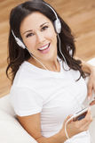 Young Woman Girl Listening to MP3 Player Headphones Royalty Free Stock Photo