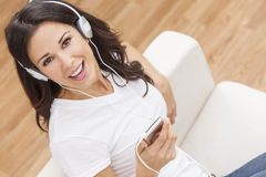 Young Woman Girl Listening to MP3 Player Headphones royalty free stock photography