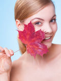 Young woman girl with red maple leaf. Stock Photo