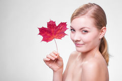 Young woman girl with red maple leaf. Stock Photos
