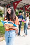 Young woman girl, student hold note book at college Stock Image