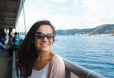 Young woman girl in sunglasses during Bosphorus cruise Royalty Free Stock Image