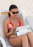 Young woman girl in sunglasses with tablet pc Stock Image