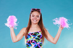 Young woman girl in swimsuit with pom poms. Stock Images