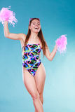 Young woman girl in swimsuit with pom poms. Gorgeous young woman girl in swimsuit swimwear with pom poms on blue. Summer holiday vacation relax Royalty Free Stock Photos