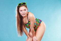 Young woman girl in swimsuit. Summer holiday. Gorgeous young woman girl in swimsuit swimwear with sunglasses on blue. Summer holiday vacation relax Stock Image
