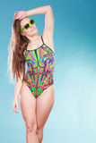 Young woman girl in swimsuit. Summer holiday. Gorgeous young woman girl in swimsuit swimwear and sunglasses on blue. Summer holiday vacation relax Royalty Free Stock Images