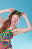 Young woman girl in swimsuit. Summer holiday. Gorgeous young woman girl in swimsuit swimwear with sunglasses on blue. Summer holiday vacation relax Stock Photography