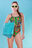 Young woman girl in swimsuit with towel. Gorgeous young woman girl in swimsuit swimwear with towel and sunglasses on blue. Summer holiday vacation relax Stock Photography