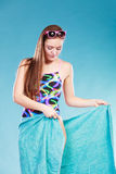 Young woman girl in swimsuit with towel. Gorgeous young woman girl in swimsuit swimwear with towel and sunglasses on blue. Summer holiday vacation relax Royalty Free Stock Image