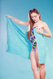 Young woman girl in swimsuit with towel. Gorgeous young woman girl in swimsuit swimwear with towel and sunglasses on blue. Summer holiday vacation relax Royalty Free Stock Photo