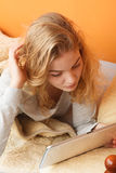 Young woman girl with tablet browsing internet. Stock Images