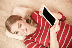 Young woman girl with tablet browsing internet. Stock Photo