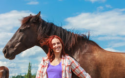 Young woman girl taking care of horse. Stock Photos
