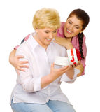 Young woman give gift to her mother stock photography