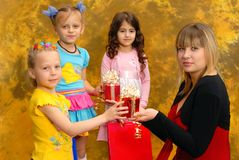 Young woman give gifts to the children Stock Photos
