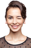 Young woman give a wink Royalty Free Stock Photos