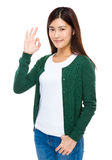 Young woman give you ok gesture Stock Images