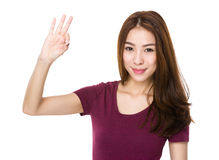 Young woman give you ok gesture Stock Photo