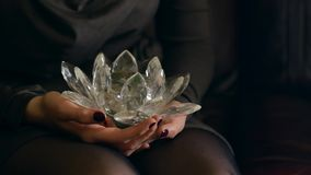 Young woman gives a crystal lotus from her heart. With love Royalty Free Stock Photography