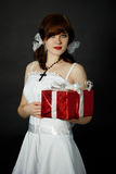 Young woman gives gift Royalty Free Stock Photography