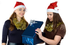 Young woman gives the gift another one Royalty Free Stock Images