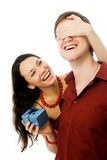Young woman gives a present to her husband Royalty Free Stock Images