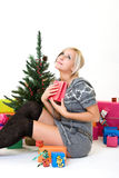 Young woman gives thanks to God at christmastime Stock Images