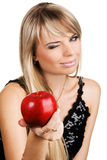 Young woman giving an apple Royalty Free Stock Photos