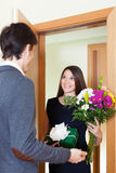 Young woman giving flowers and gift Royalty Free Stock Photo
