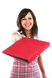 Young woman giving a folder Royalty Free Stock Photos