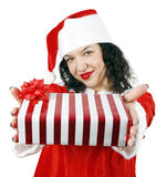 Young woman giving a gift Royalty Free Stock Photography