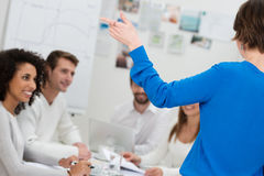 Young woman giving a group presentation Stock Images
