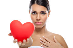 Young woman giving heart Royalty Free Stock Images