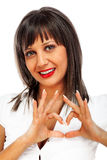 Young woman giving heart sign Stock Images