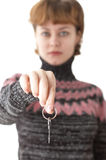 Young woman giving a key from door Stock Image