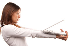 Young woman giving laptop computer Stock Images
