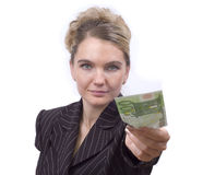 Young woman giving money. Young woman giving 100 Euro on white background Royalty Free Stock Image