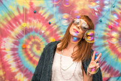 Young woman giving peace sign, with bubble stock image