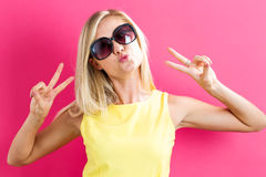Young woman giving the peace sign Stock Image