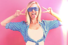 Young woman giving the peace sign Stock Images