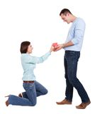 Young woman giving present to her boyfriend Stock Photos