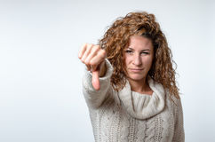 Young woman giving a thumb down gesture Stock Photo