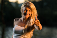Young Woman Giving A Thumbs Up Stock Photos