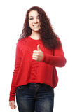 Young woman giving thumbs up Stock Image