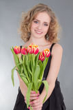 Young woman giving tulip flowers Stock Photo